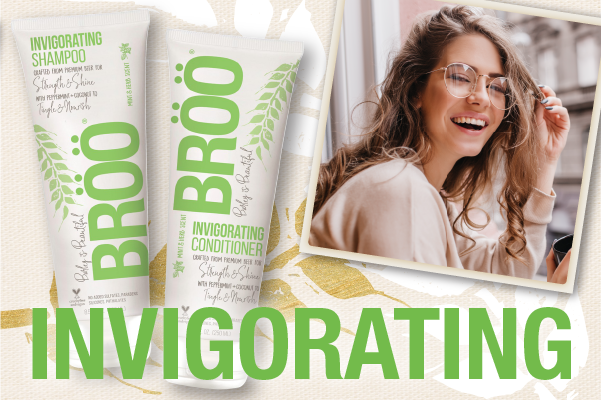 link to invigorating collection picture of shampoo, conditioner and woman with long hair
