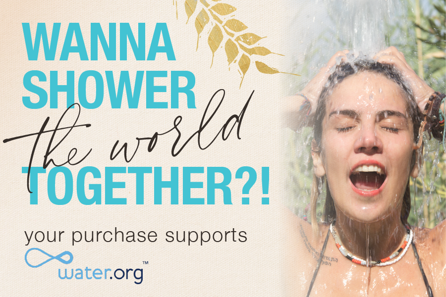 your purchase supports water.org - girl standing under running water - links to shower the world page
