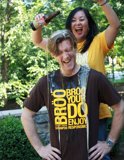 Brad and Sarah, founders of Broo hair care. Sarah is pouring beer over Brad's head.