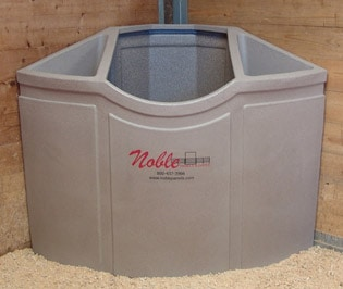 Corner feeders in stalls can significantly reduce the waste of hay.
