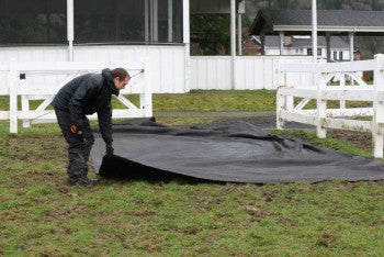 Lighthoof recommends the use of 6-8oz non-woven geotextile fabric as a barrier between Lighthoof panels and the muddy ground they are installed over
