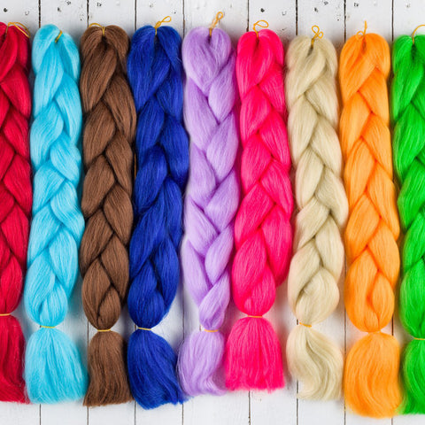 Packets of braid hair laid out showing colours