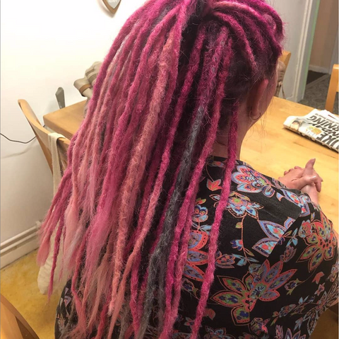 Girls hair showing dreadlocks installed using synthetic braid hair from dreadlab