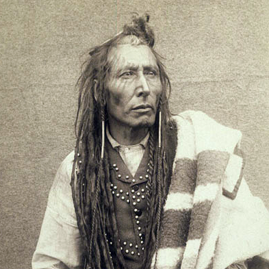 Black and white photo of native indian with dreadlocks