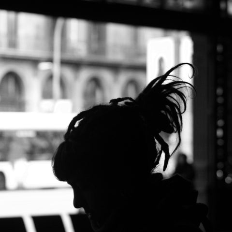 Black and white image of side view of girl with dreadlocks