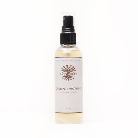 Bottle of Creeps Tincture Raw Roots