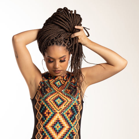 Girl with hands on head playing with dreadlocks