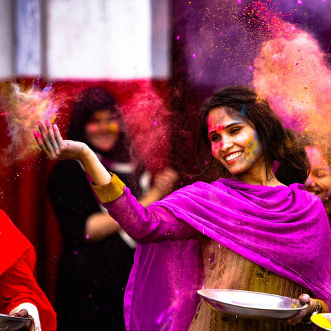Indian woman smiling at festival