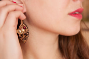 Wooden Earring with a small metal bird
