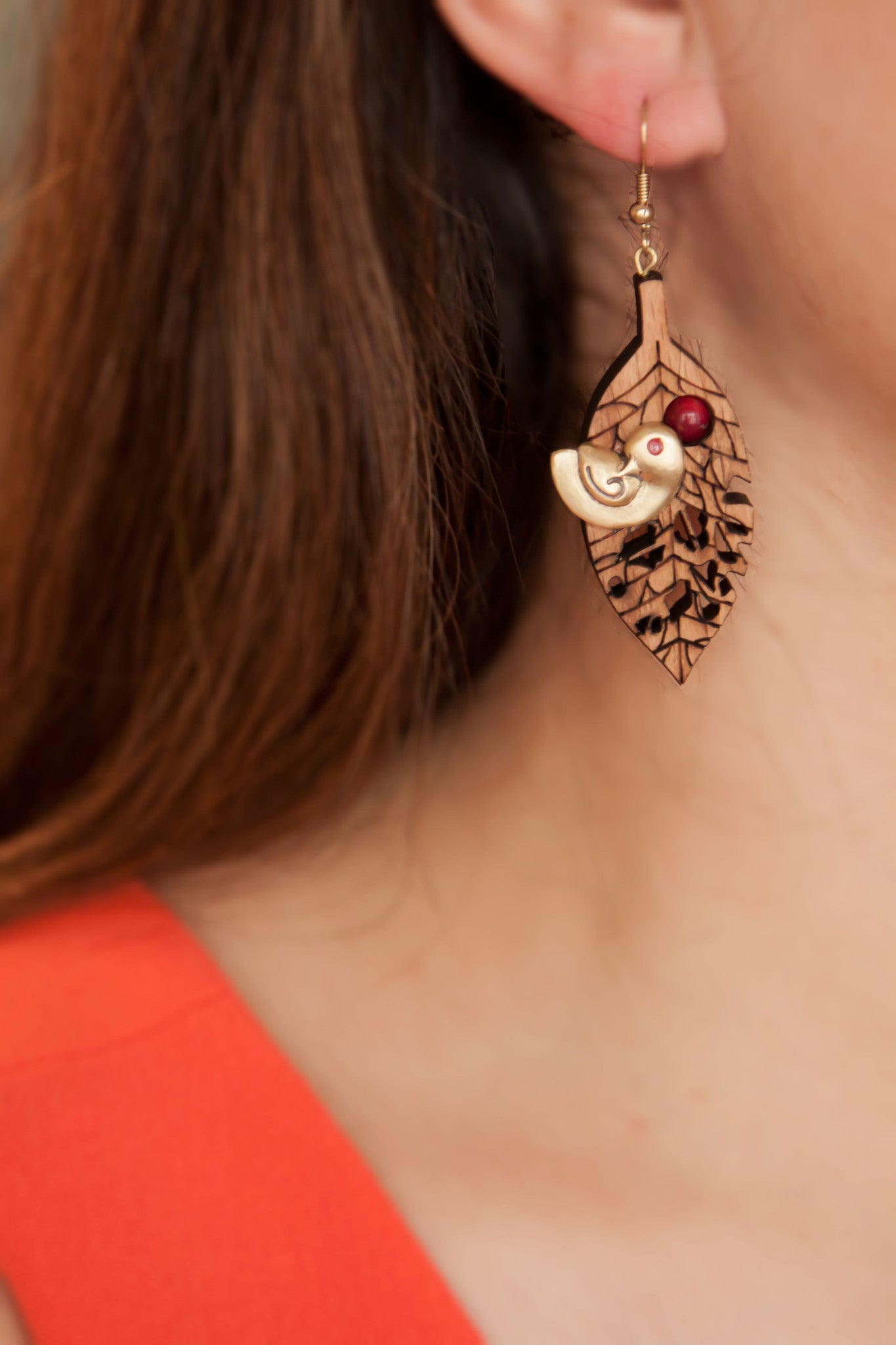 Wooden Earring with a small metal bird - artsy artworks