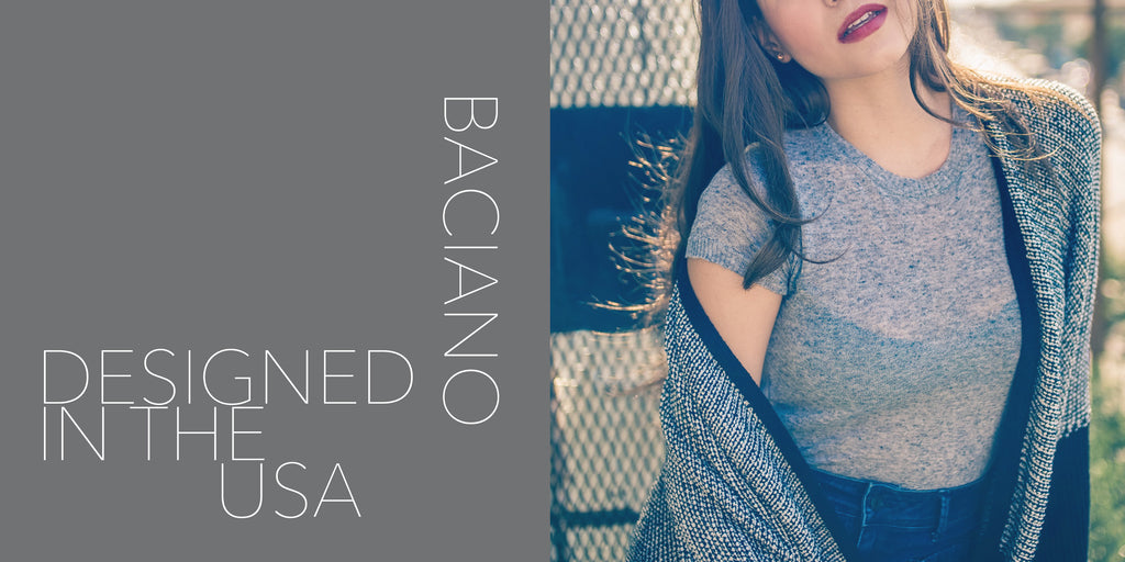 USA made pieces online, woman wearing a sweater, baciano womens fashion, women posing on a balcony, baciano styled in los angeles, our designs originated in the united states, designed in the united states, models wearing baciano designer clothing, model wearing a designer sweater, model wearing red lipstick, model wearing a gray top with black and white sweater