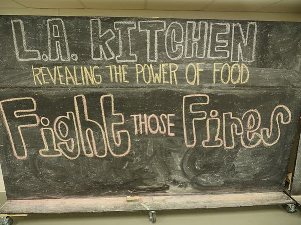 los angeles fighting fires. feeding program. fashion people feeding the less fortunate.