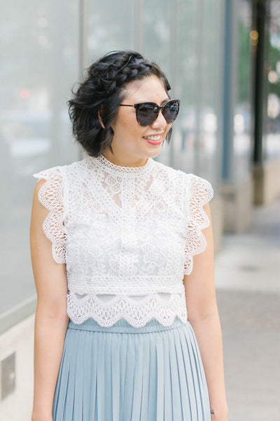 styling your palazzo pants with a lace top.
