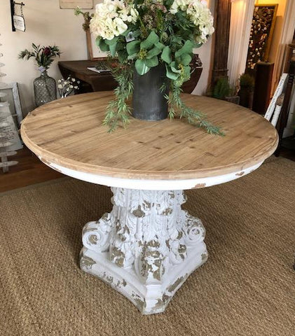 Round Distressed Pedestal Table for $ 750.00