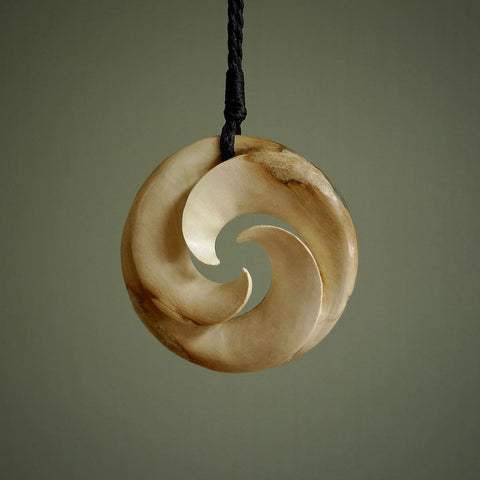 Woolly Mammoth tusk pendant. Hand carved by NZ Pacific. Handmade jewellery for sale online.