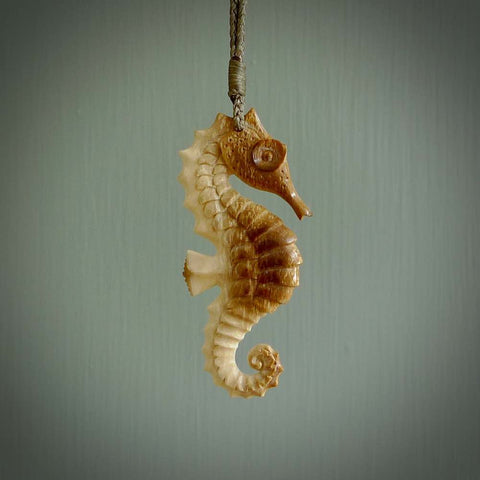 Hand carved mammoth tusk seahorse pendant. Handmade jewellery for sale online.