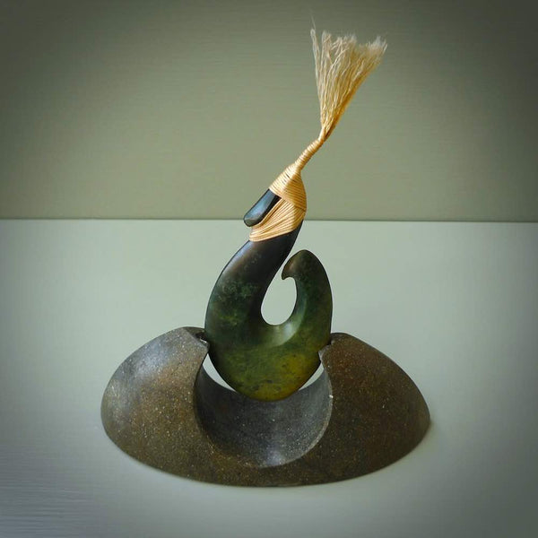 Hand carved New Zealand Flower Jade Hook with Greywacke stand sculpture. Hand carved in New Zealand by Ric Moor. This is a one only sculpture and is a beautiful, large, display piece.