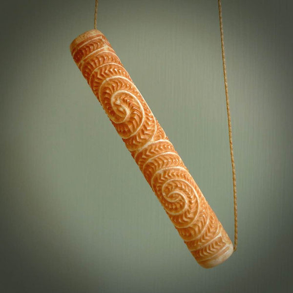 A traditional hand carved Māori flute. This piece is made from bone and is a fully functioning musical instrument and can be played. Beautiful ethnic art hand made by NZ Pacific.