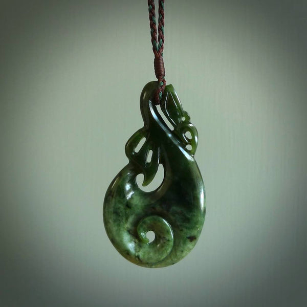 Hand carved flower jade manaia pendant. Carved from beautiful New Zealand Jade for NZ Pacific. Unique jade jewellery for sale online.