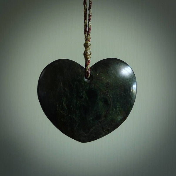 A hand carved heart pendant made from New Zealand Karaka jade. This is a large ands visually striking piece, beautifully curved and sensuous. The perfect piece of jewellery for someone you love.