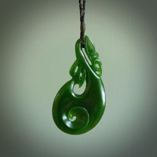 Hand carved green jade manaia pendant. Carved from crisp green kahurangi New Zealand Jade for NZ Pacific. Unique jade jewellery for sale online.