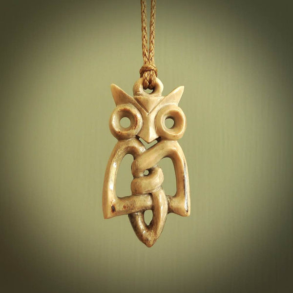A traditional Celtic Owl design carving, hand made for us from bone. This is a work of art and is a collectable piece of traditional bone carving. It can be worn as a special piece of jewellery or displayed. This is art made to wear at its finest.