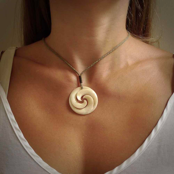 Hand carved bone pendant. Made for NZ Pacific. A koru design necklace.