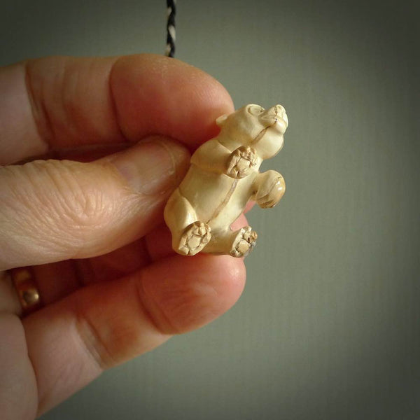 This picture shows a pendant that we designed in Woolly Mammoth Tusk. It is a little Panda bear that has a walking stance and is carved in detail. A really attractive and eye-catching piece of handmade jewellery. The cord is hand plaited braid in black and pale honey and the length can be adjusted.