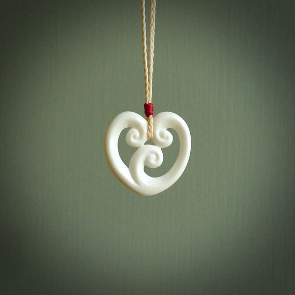 Hand carved bone pendant. Contemporary design with a traditional accent. Made in New Zealand for NZ Pacific.