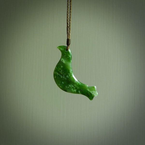 This pendant is a hand carved contemporary bird pendant. Carved in nephrite jade. It is a finely shaped piece with gentle and soft lines and is a great representation of the peace that doves traditionally represent. We ship these worldwide with DHL express courier. A fantastic and meaningful gift.