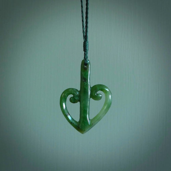 This is a beautiful koru pendant designed with a little inspiration from our national airline, Air New Zealand. It is carved from green jade which we source in Aceh and it is a lovely bright green with some dark speckled inclusions. A wonderful pendant.