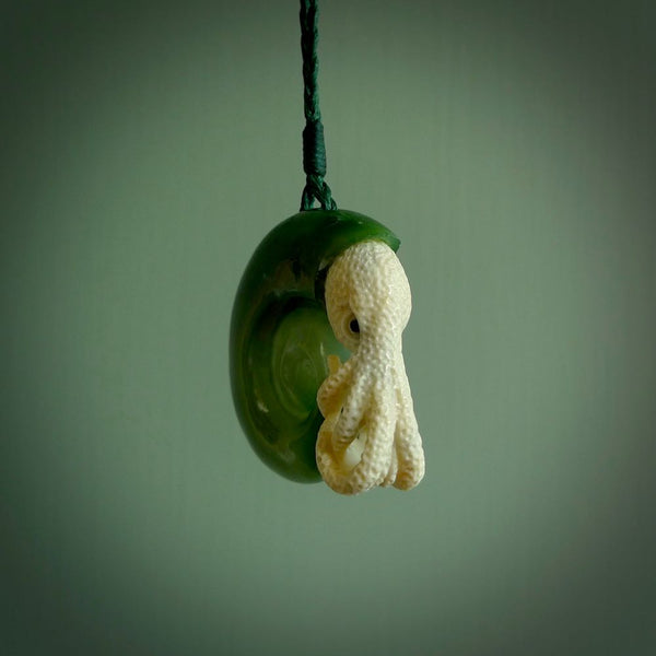 A pendant for lovers of all things unique, beautifully handcrafted and dazzling. This pendant is our design of an ancient ammonite handcarved from green nephrite jade and bone. It's a beauty and will make someone a fabulous piece of unique jewellery.
