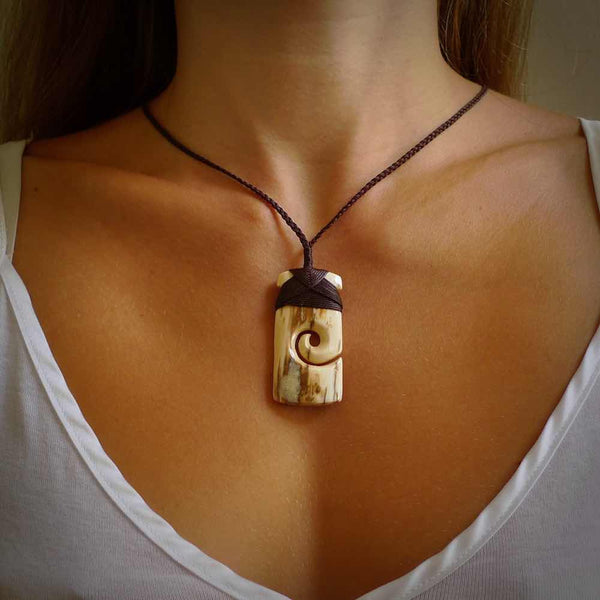 Hand carved woolly mammoth tusk toki pendant. Hand carved by NZ Pacific. Handmade jewellery for sale online.