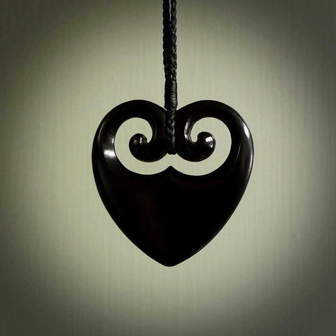 Black jade heart with koru. Hand carved from Australian black jade. Jewellery for sale online.