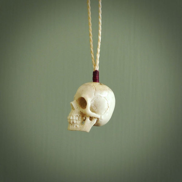 These are little handmade skull pendants carved from woolly mammoth tusk. A fantastic piece if you like skulls and would like a small piece. The cord is adjustable so you can wear this where it suits you best. We ship these free worldwide.
