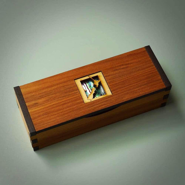Jewellery box made from Native Rimu veneer wood. These boxes have various designs carved into the top and have a hinged, flip lid. They are very functional, well made and strong.
