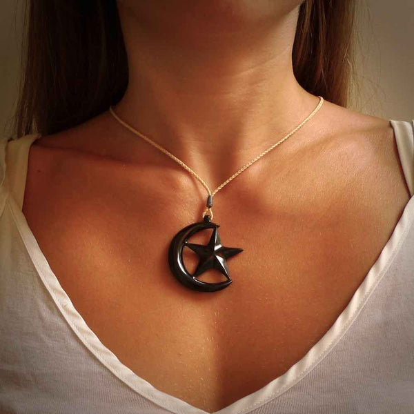 Hand carved black jade crescent moon pendant. Jade jewellery made by NZ Pacific for sale online.