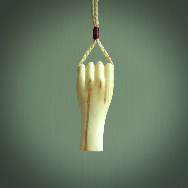 Hand carved woolly mammoth hand pendant. Carved by NZ Pacific and for sale online. Unique, handmade jewellery.