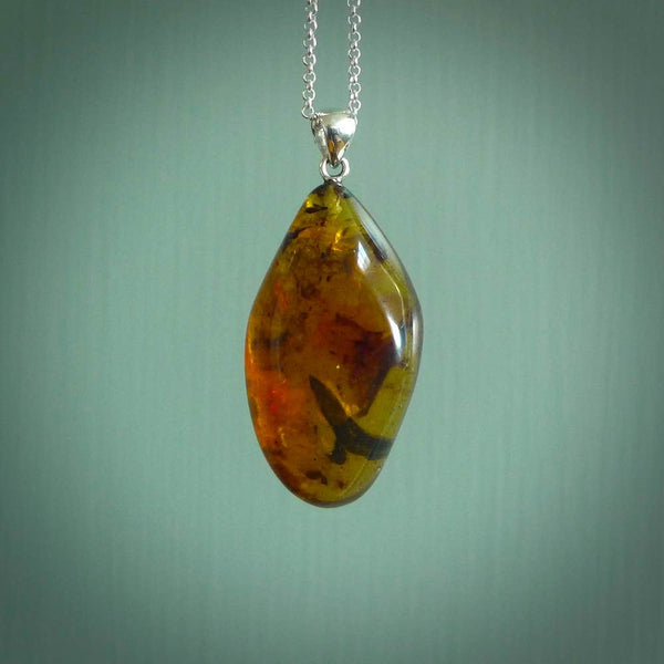 A beautiful amber pendant. This piece is made from amber that we bought in Indonesia. It is a rare material that has a lovely look and feel and makes a very striking piece of jewellery. We ship this postage paid worldwide.