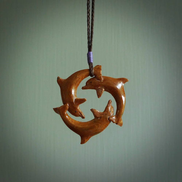 This is a little circle of three dolphins carved by hand from Woolly Mammoth tusk. It is a lovely handmade pendant that will make a fabulous gift and piece of jewellery for lovers of dolphins. Free delivery worldwide.