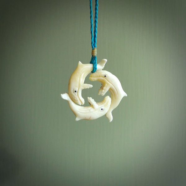 Hand carved natural bone whale trilogy pendant. Art to wear. Ocean themed pendants.