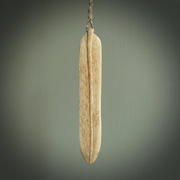 Hand carved frog on bamboo leaf netsuke pendant. Carved for NZ Pacific by Fumio Noguchi. Tiny Dancer has been carved from deer antler and has goat horn eye inlays. This is a detailed and meaningful pendant handcarved by one of New Zealand's finest bone carvers. We ship this worldwide and postage is paid.