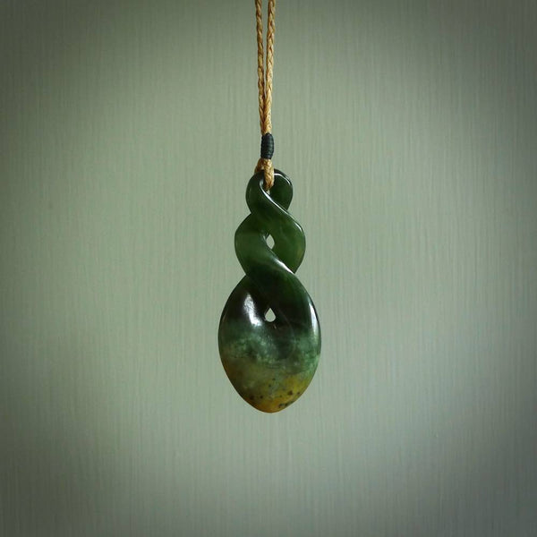 Hand carved New Zealand jade twist pendant. Carved in New Zealand by NZ Pacific. Māori themed jewellery for sale online.