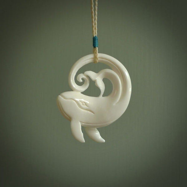 A hand carved bone whale pendant. This is a lovely piece carved to bring pleasure to the lucky wearer. It is a friendly pendant which we will ship to you free wherever you live. Carved by NZ Pacific and for sale online.