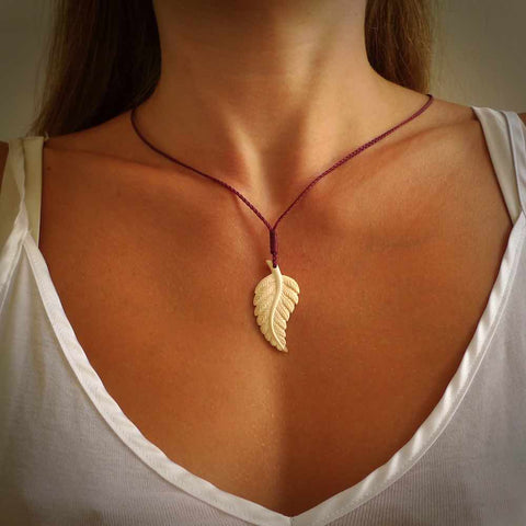 Hand carved woolly mammoth tusk fern pendant. Made in New Zealand.