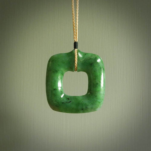 Hand carved jade pendant. Carved by NZ Pacific from New Zealand jade. This is a modern, contemporary pendant made from natural materials.