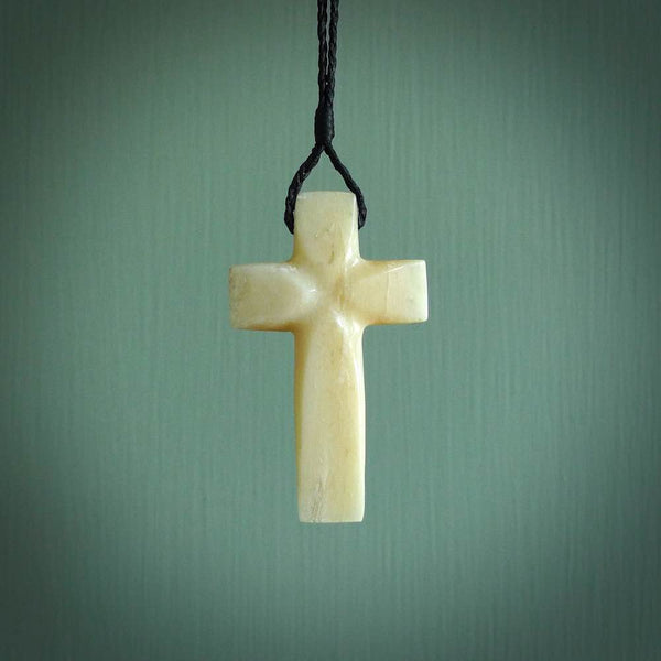 Hand carved Marlin Bill cross shown worn. Religious symbol pendant. Christian cross pendant for sale online.