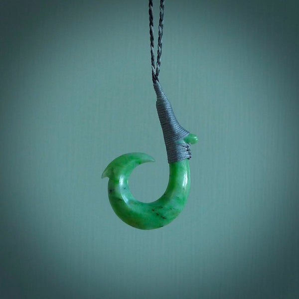 These pendants are hand carved, green jade Hawaiian hooks or Makau pendants. They are beautifully finished in a high polish and bound with a Black/Silver cord and a Silver Binding. Hand made jewellery that make the most wonderful gifts. Free shipping worldwide.