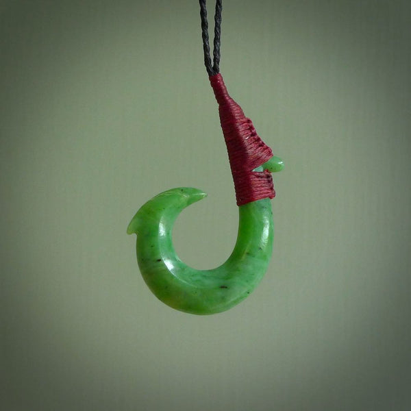 These pendants are hand carved, green jade Hawaiian hooks or Makau pendants. They are beautifully finished in a high polish and bound with a Black cord and a Pohutukawa Red Binding. Hand made jewellery that make the most wonderful gifts. Free shipping worldwide.