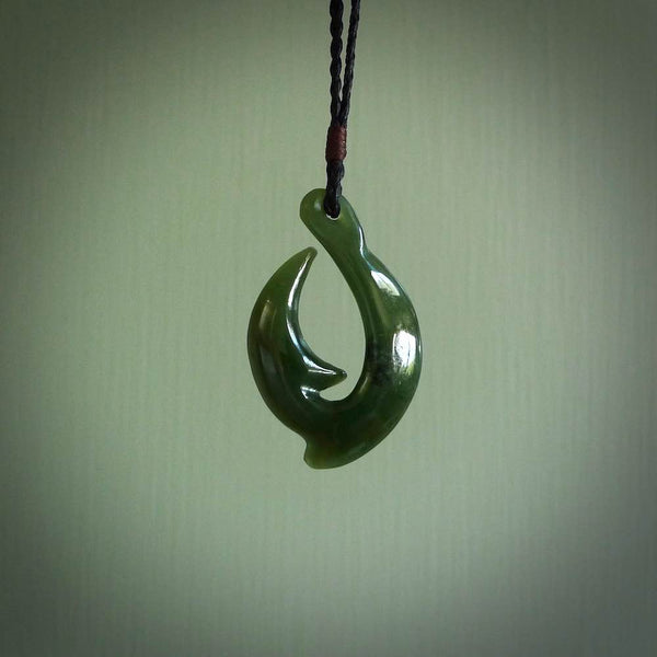 Greenstone hei-matau pendant. Hand carved fish hook made from New Zealand jade. Carved by Ross Crump.